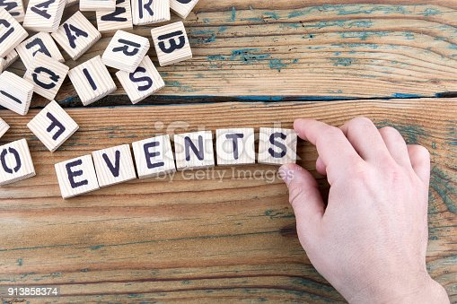 events. Wooden letters on the office desk, informative and communication background
