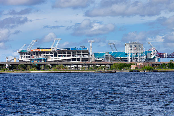 EverBank Field in Jacksonville, Florida Jacksonville, Florida, USA - July 15, 2012: View of EverBank Field in Jacksonville, Florida from the St John River. EverBank Field is the home stadium of the National Football League 's Jacksonville Jaguars. It also  hosts  a post-season college Gator Bowl game. The stadium hosted Super Bowl XXXIX in 2005 ncaa college football stock pictures, royalty-free photos & images