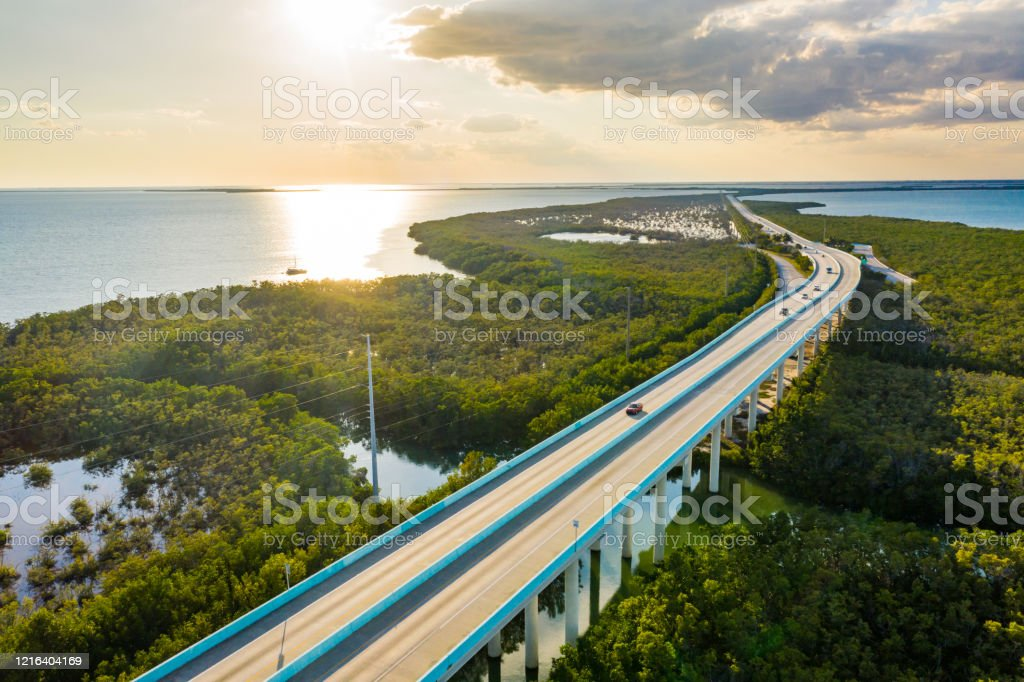 Everglades National Park at sunset, Florida, USA Landscape with an aerial view of bridge and wetlands in Everglades National Park at sunset, Florida, USA Aerial View Stock Photo