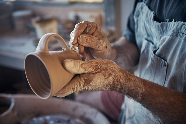 Every cup he makes is unique Cropped shot of a craftsman working on his pottery in his workshopimage806442.jpg ceramics stock pictures, royalty-free photos & images
