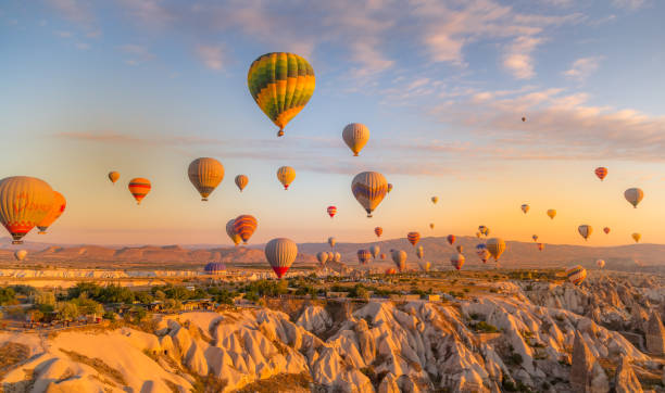 Every day over 100 balloons fly taking tourist on a magical view of Nevsehir stock photo