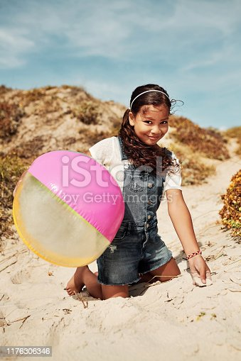 Shot of an adorable little girl having a fun day at the beach