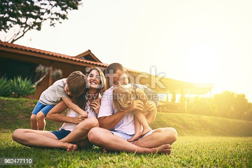 Shot of a happy family bonding together outdoors
