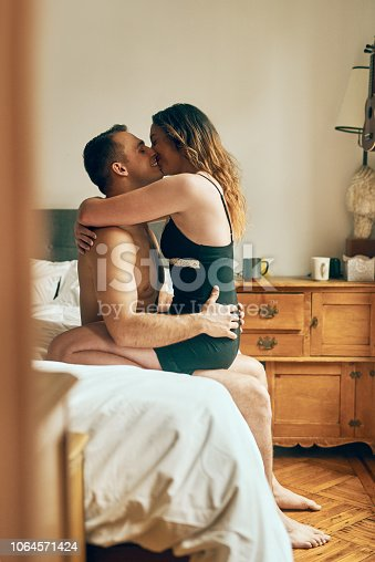 Shot of an affectionate young couple spending a romantic morning in bed at home