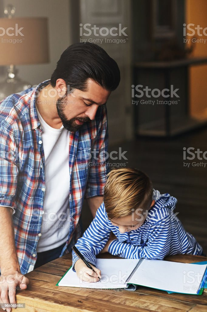 Every parent naturally plays the role of teacher too - Royalty-free Adult Stock Photo