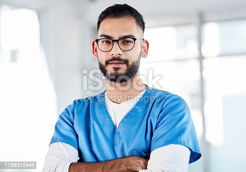 Portrait of a confident young doctor working in a hospital