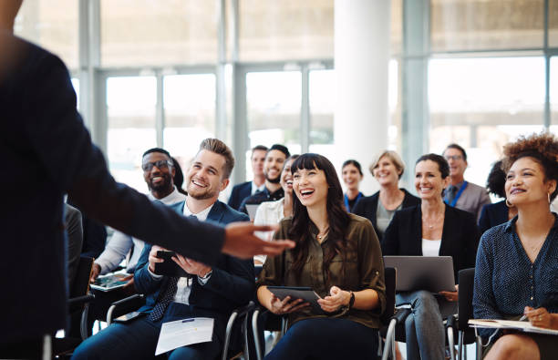 Every presenter's dream, an audience full of go getters stock photo