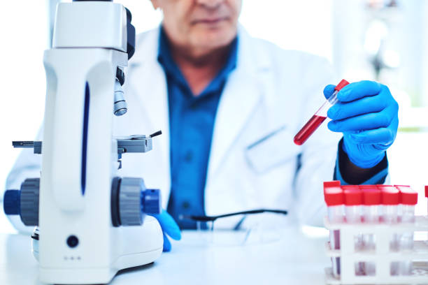 Every sample has a big story to tell Closeup shot of a scientist analyzing samples in a laboratory biochemist stock pictures, royalty-free photos & images