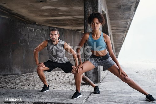 Full length shot of a sporty young couple exercising together outdoors