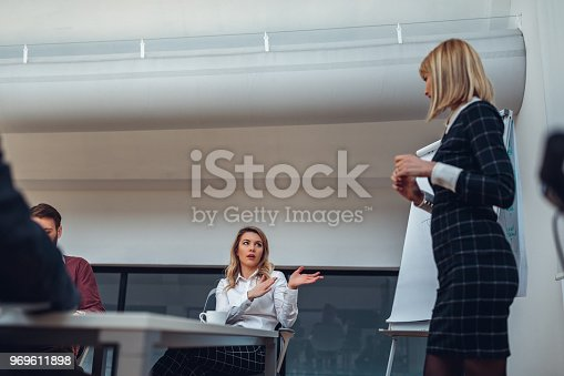Shot of two young businesswoman discussing at the meeting
