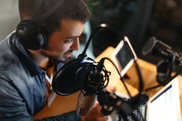 Everybody's favourite presenter Photo of young man recording a podcast in a studio radio dj stock pictures, royalty-free photos & images
