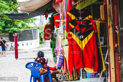 Photo taken in Dili, East Timor or Timor Leste, March 2016. Candid depictions of everyday life in Timor Leste or East Timor, although an underexplored touristic destination, this country features some of the best beaches in the world. City life is full of color, simplicity (seen in street food stalls) and life as it is, on the move. People that are open and engage with the camera. Editorial use only.