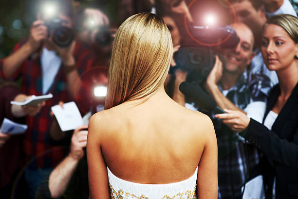 everyone wants a piece of her - celebrity lifestyle - celebrities stock pictures, royalty-free photos & images