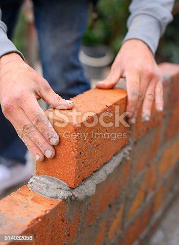 Shot of a master bricklayer at work