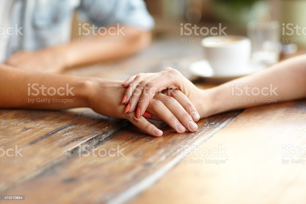 Everything is going to be alright Closeup of a young couples hands holding eachother over a coffee tablehttp://195.154.178.81/DATA/i_collage/pi/shoots/780574.jpg 2015 Stock Photo