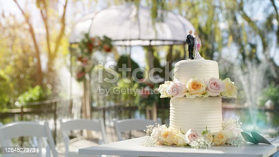 Still life shot of a wedding cake on a table outside