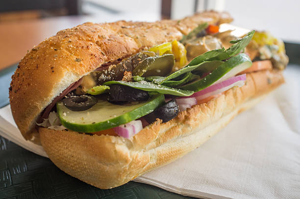 Everything Sub Sandwich Stuffed overflowing huge spicy sub sandwich with every topping submarine sandwich stock pictures, royalty-free photos & images