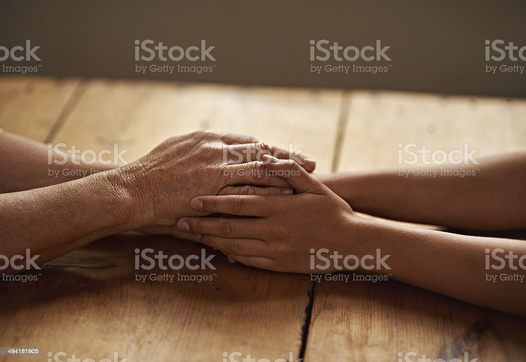 Everything will be alright A cropped shot of a woman holding a loved one's hand in support Adult Stock Photo