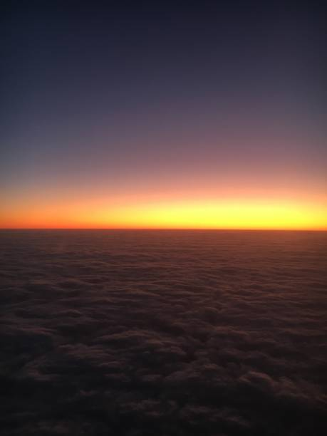 Everything will be fine: sunrise seen from the window of an airplane - foto stock