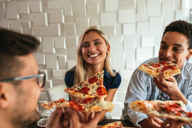 everything's better when you do it with friends - pizzeria stock photos and pictures