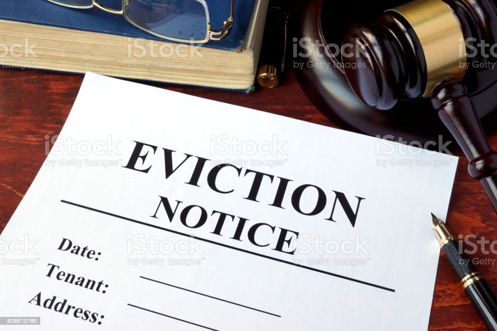 Eviction notice and gavel on a table. stock photo