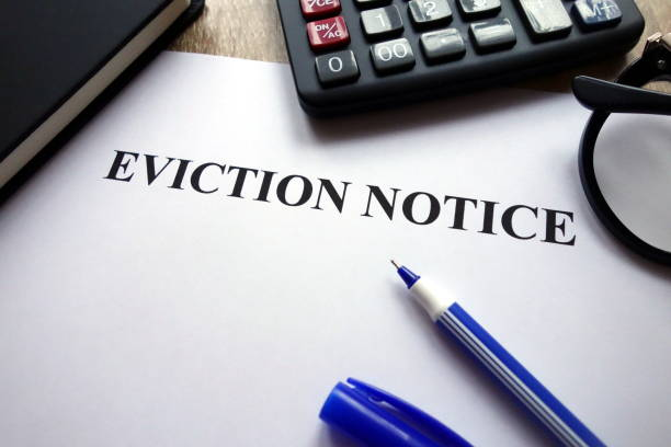 Eviction notice document, pen, glasses and calculator Eviction notice document, pen, glasses and calculator on desk information sign stock pictures, royalty-free photos & images