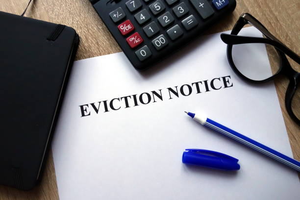 Eviction notice document Eviction notice document, pen, glasses and calculator on desk information sign stock pictures, royalty-free photos & images