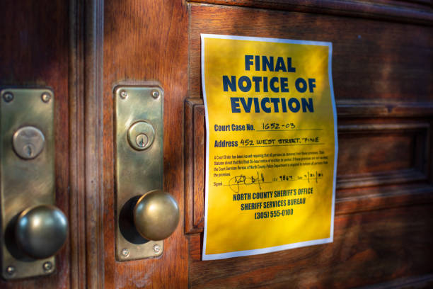 Eviction notice on door of house stock photo