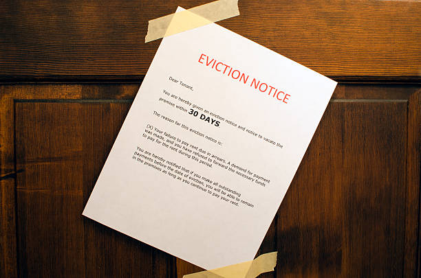 Eviction Notice An eviction notice taped to a door. information sign stock pictures, royalty-free photos & images