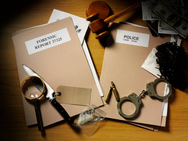 evidence from a crime with handcuffs and gavel - murder mystery stock photos and pictures
