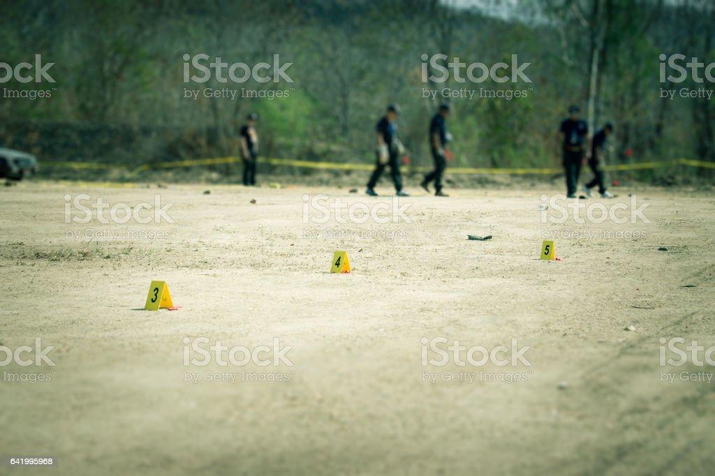 Beweis-Marker mit forensischen Hintergrundunschärfe in Cenematic Ton – Foto