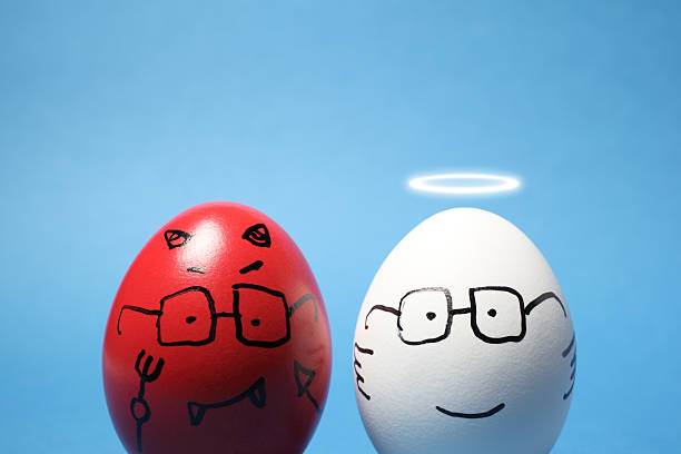 Evil and Angel Eggs stock photo