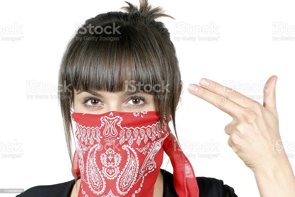 Evil brunette girl in red bandanna stock photo