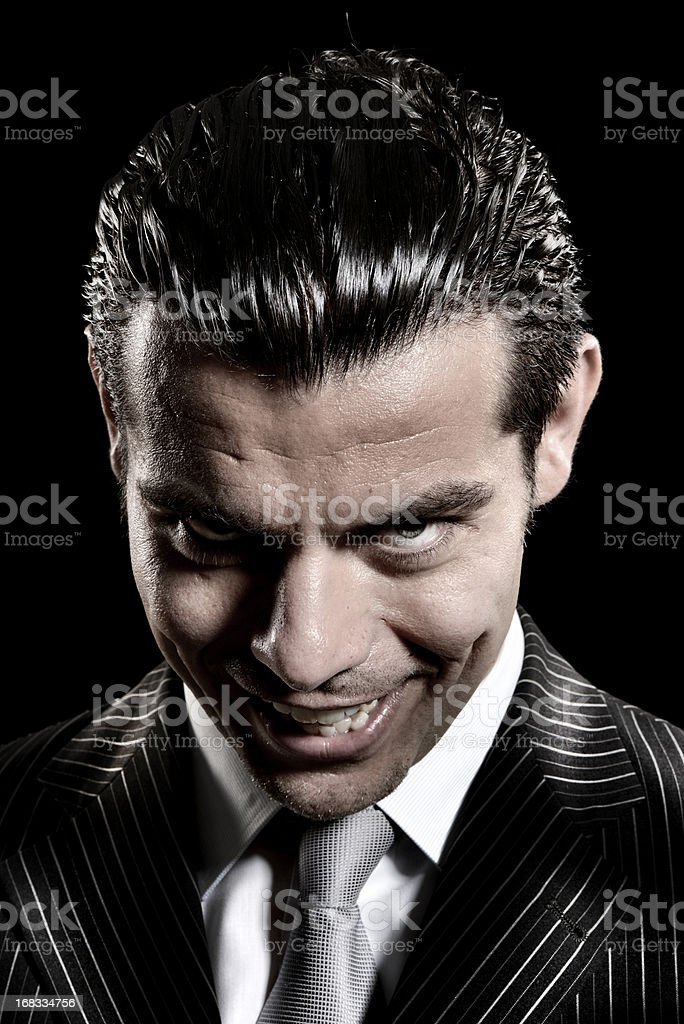 Evil businessman look stock photo
