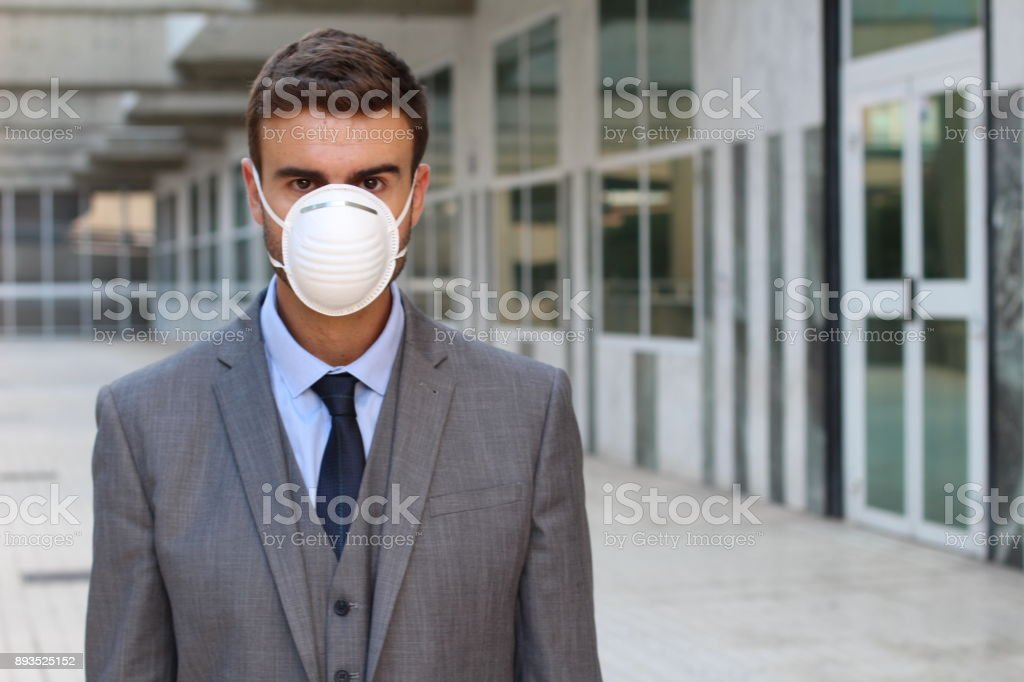Evil CEO wearing a breathing mask stock photo