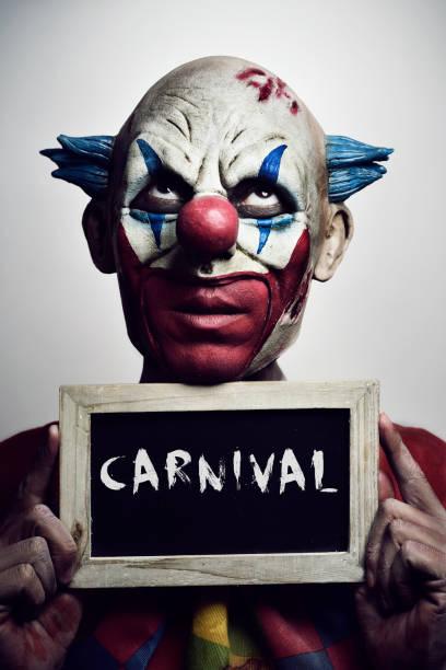 evil clown and text carnival - faschingssprüche stock-fotos und bilder