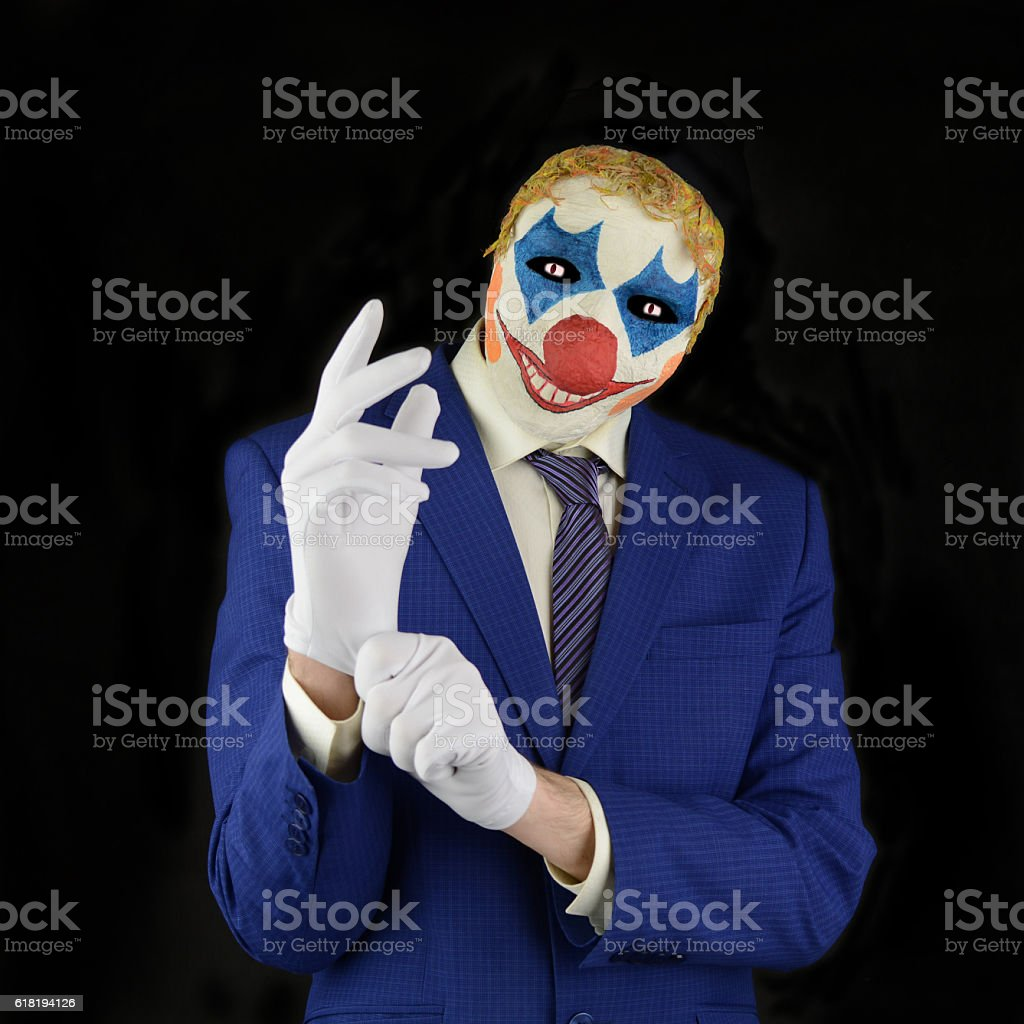 Evil clown on black background stock photo