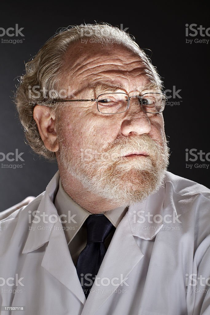 Evil doctor with sinister expression stock photo