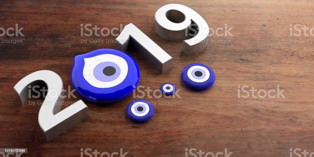 Evil eye amulet, protection, lucky New Year, 2019, banner, miscellaneous sizes on wooden background. 3d illustration stock photo