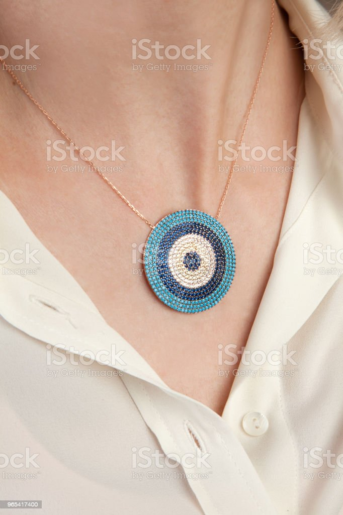 Evil Eye Gold Necklace With Stones royalty-free stock photo
