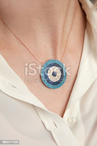 Evil Eye Gold Necklace With Stones Stock Photo & More Pictures of Adult