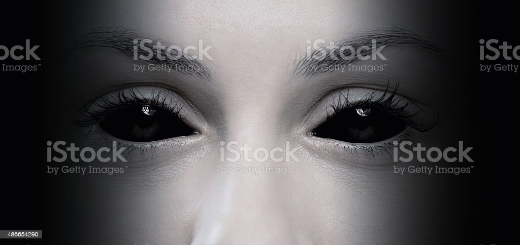 Evil female eyes stock photo