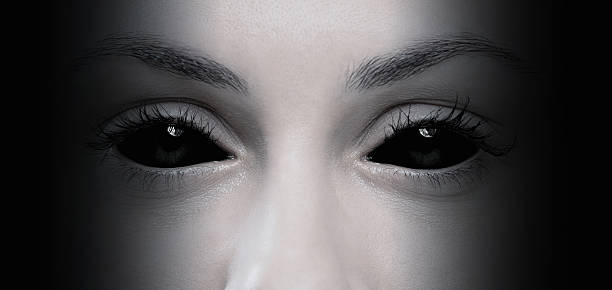 evil female eyes - demon stock photos and pictures