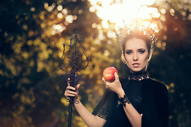 evil queen with poisoned  apple in fantasy portrait - 白雪姫 ストックフォトと画像