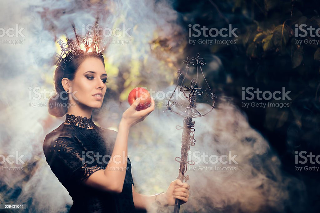 Evil Queen with Poisoned  Apple in Misty Forest - Photo