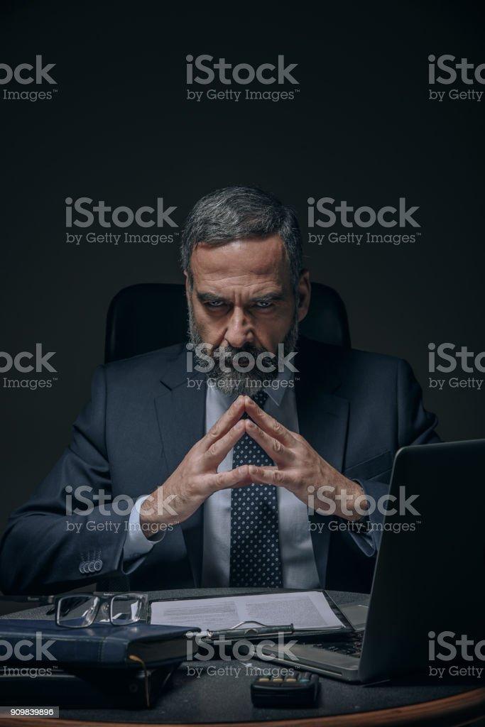 Evil senior business man royalty-free stock photo