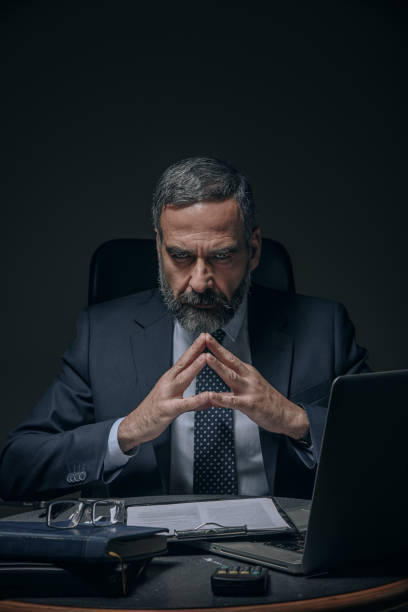 Evil senior business man Senior boss, evil corporate overlord in the dark greed stock pictures, royalty-free photos & images