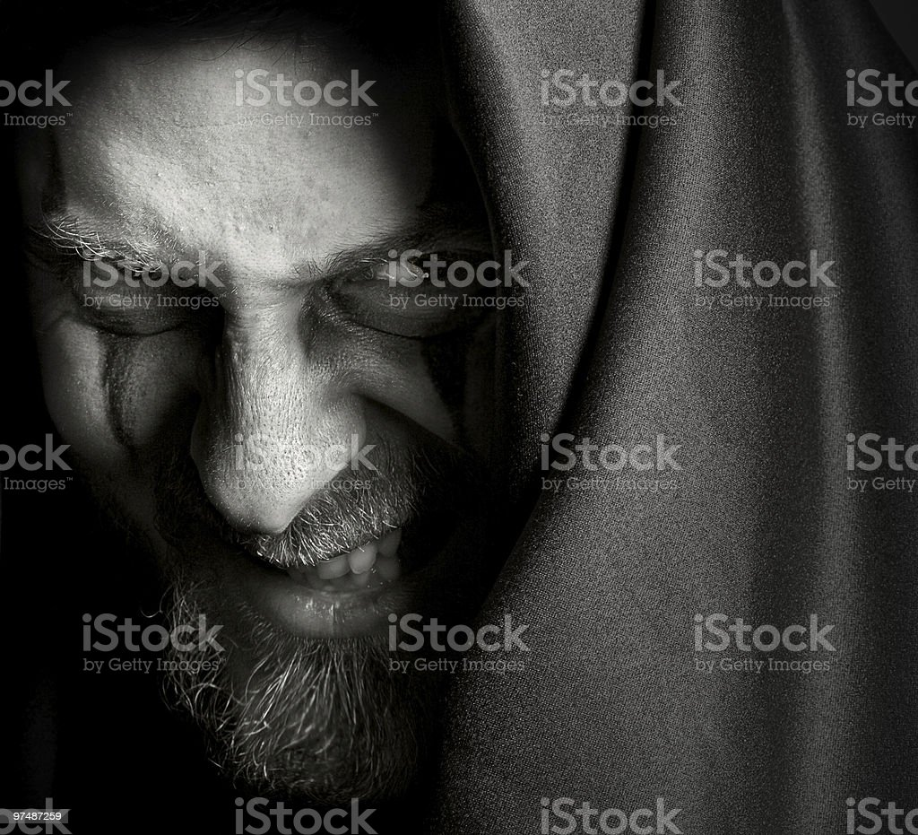 Evil sinister man with malefic wicked grin royalty-free stock photo