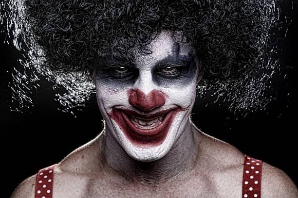 Mal Spooky payaso sonriente - foto de stock