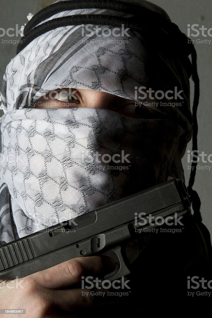 Evil Taliban man with a weapon stock photo